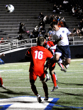 Enid's Angel Chavez heads the ball into the Del City goal for the Plainsmen's second point at D. Bruce Selby Stadium Friday, March 8, 2013. (Staff Photo by BONNIE VCULEK)