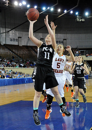 Pond Creek Hunter's Rylie Halcomb gets behind Cheyenne/Reydon's Morgan Latta for a basket in a class A state semi-final Friday at the State Fair Arena in Oklahoma City. (Staff Photo by BILLY HEFTON)