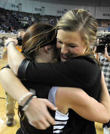 Pond Creek-Hunter coach, Tasha Diesselhorst, hugs Jade Jones after the Lady Panthers  defeated Seiling Saturday at the State Fair Arena in Oklahoma City. (Staff Photo by BILLY HEFTON)