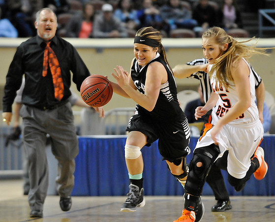 Pond Creek Hunter's Jade Jones races Cheyenne/Reydon's Morgan Latta upcourt in a class A state semi-final Friday at the State Fair Arena in Oklahoma City. (Staff Photo by BILLY HEFTON)