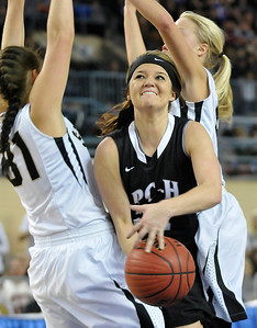 Pond Creek-Hunter's Jade Jones splits a double team for a shot against Seiling as the Lady Panthers defeated Seiling Saturday at the State Fair Arena in Oklahoma City. (Staff Photo by BILLY HEFTON)