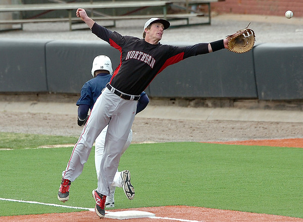 NOC Enid first baseman, Jerame Littell reaches for a wide throw against DMACC Sunday at David Allen Memorial Ballpark. (Staff Photo by BILLY HEFTON)