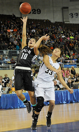 Pond Creek-Hunter's Tiarra Davis scores a basket against Seiling's Kylie Templin as the Lady Panthers defeated Seiling Saturday at the State Fair Arena in Oklahoma City. (Staff Photo by BILLY HEFTON)