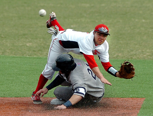 NOC Enid's Dyce Applegate tumbles over DMACC's Cosimo Cannella as he throws to first to complete a double play Saturday during the first game of a doublehitter at David Allen Memorial Ballpark. (Staff Photo by BILLY HEFTON)