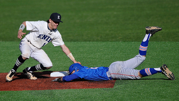 Enid's Cole Floyd tags out Bixby's Tanner Griffin at second base Monday at David Allen Memorial Ballpark. (Staff Photo by BILLY HEFTON)