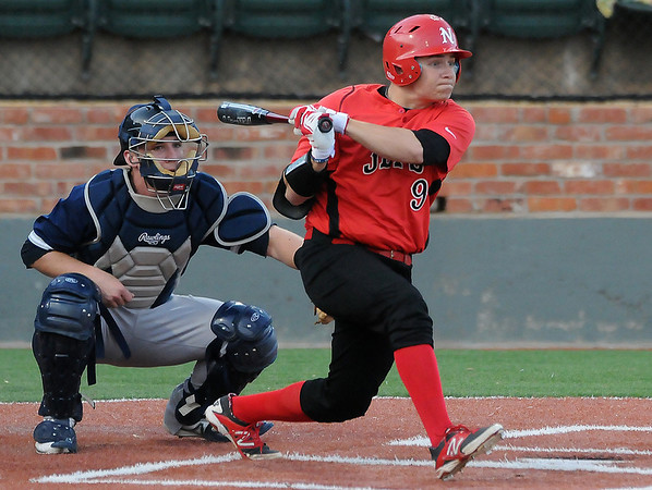 NOC Enid's Russ Colgan connects on a single against DMACC Friday at David Allen Memorial Ballpark. (Staff Photo by BILLY HEFTON)