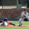 Enid firstbaseman, Braden Rogers waits on the ball as OKC Broncos' Issac Waitman dives back into the base Tuesday at David Allen Memorial Ballpark. (Staff Photo by BILLY HEFTON)