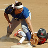 NOC Enid's Jazmine White dives back into first base ahead of the tag from NEO's Laura Ashlock Thursday at Pacer Field. (Staff Photo by BILLY HEFTON)