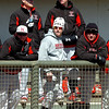 Various types of headgear was used by members of the NOC Enid baseball team Sunday to ward off the cold north wind. (Staff Photo by BILLY HEFTON)