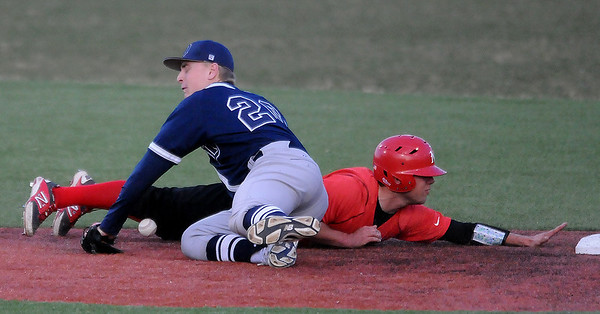 NOC Enid's Dyce Applegate dives back into second base as DMACC's Tyler Wolfe bobbles a throw Friday at David Allen Memorial Ballpark. (Staff Photo by BILLY HEFTON)