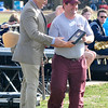 Jeremy Clickner accepts the Athlete of the Year Award from Enid football coach, Steve Chard, during the opening ceremonies of the Special Olympics Thursday at Vance Air Force Base. (Staff Photo by BILLY HEFTON)