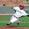 NOC Enid's Jared Thompson prepares to slide across home plate against DMACC Saturday during the first game of a doublehitter at David Allen Memorial Ballpark. (Staff Photo by BILLY HEFTON)
