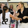 Pond Creek Hunter coach, Tasha Diesselhorst, greets Jaden Jones at the end of the Lady Panthers win over Caddo during the first round of the state basketball tournament Thursday at the State Fair Arena in Oklahoma city. (Staff Photo by BILLY HEFTON)