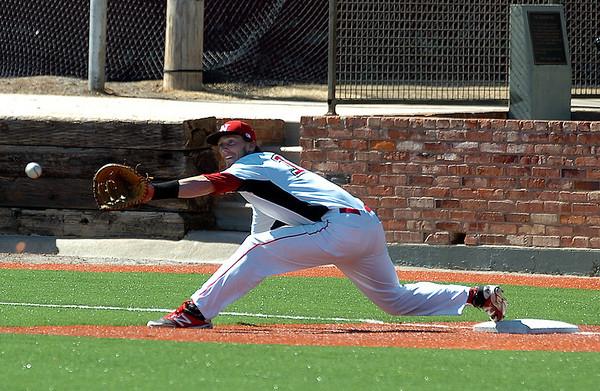 NOC Enid first baseman, Jerame Littell, streches for a wide throw Monday at David Allen Memorial Ballpark against Northern Iowa Area Community College. (Staff Photo by BILLY HEFTON)