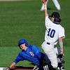 Enid's Cole Floyd shows the umpire the ball after tagging out Bixby's Tanner Griffin at second base Monday at David Allen Memorial Ballpark. (Staff Photo by BILLY HEFTON)