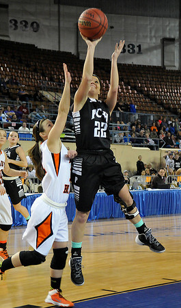 Pond Creek Hunter's Jade Jones shoots against Cheyenne/Reydon's Kaylie Springer in a class A state semi-final Friday at the State Fair Arena in Oklahoma City. (Staff Photo by BILLY HEFTON)