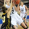 Pond Creek Hunter's Jade Jones runs into Caddo's Shelby Dellinger as she puts up a shot during the first round of the state basketball tournament Thursday at the State Fair Arena in Oklahoma city. (Staff Photo by BILLY HEFTON)