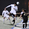 Enid's Felix Mora heads the ball on goal against Woodward Tuesday at D. Bruce Selby Stadium. (Staff Photo by BILLY HEFTON)