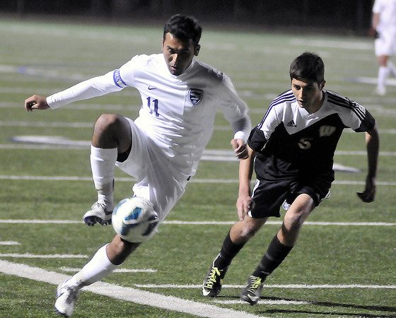 Enid's Felix Mora controls the ball against Woodward Tuesday at D. Bruce Selby Stadium. (Staff Photo by BILLY HEFTON)