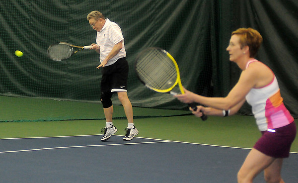 Dave Callant hits a return as he plays mixed doubles with his wife, Kelly, during the Larry McClure-Edward Jones Tennis Cup at Oakwood Country Club Saturday, March 8, 2014. Oakwood Country Club and Enid Tennis Association competed during the event. (Staff Photo by BONNIE VCULEK)