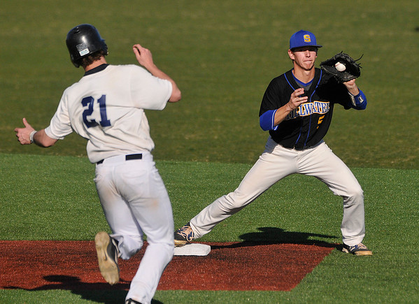 Stillwater's Harrison Cornforth forces out Enid's Braden Rogers as he turns to complete a double play Thursday at David Allen Memorial Ballpark. (Enid News & Eagle Photo by Billy Hefton)