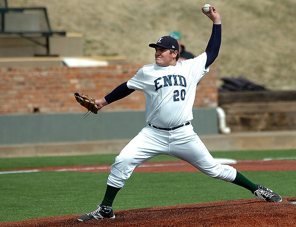 Enid's Bates Enmeier delivers a pitch against Grove Monday at David Allen Memorial Ballpark. (Staff Photo by BILLY HEFTON)
