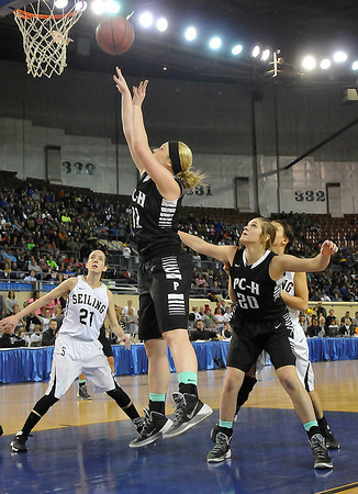Pond Creek-Hunter's Rylie Halcomb scores a basket against Seiling as the Lady Panthers defeated Seiling Saturday at the State Fair Arena in Oklahoma City. (Staff Photo by BILLY HEFTON)