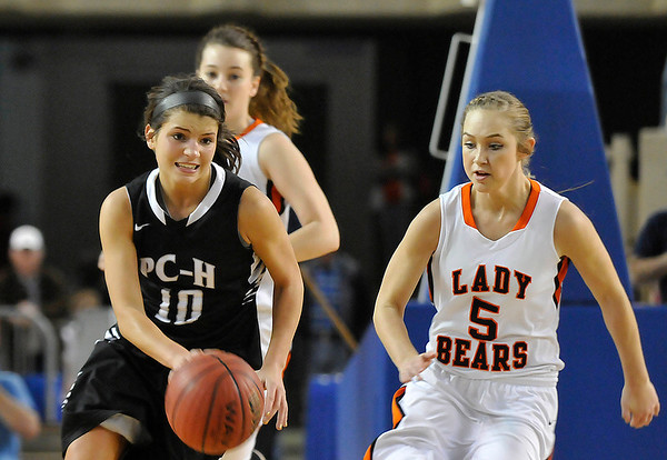 Pond Creek Hunter's Tiarra Davis dribble pass Cheyenne/Reydon's Morgan Latta in a class A state semi-final Friday at the State Fair Arena in Oklahoma City. (Staff Photo by BILLY HEFTON)