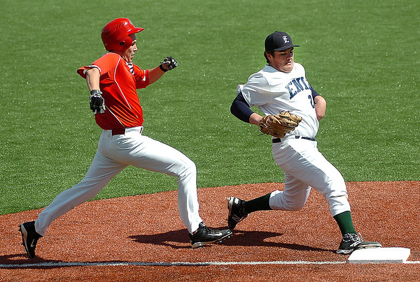 Enid's Bates Enmeier out races a Grove baserunner to firstbase Monday at David Allen Memorial Ballpark. (Staff Photo by BILLY HEFTON)