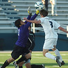 Enid's Pedro Braga has the ball knocked away by the Tulsa Washington goalkeeper Tuesday at D. Bruce Selby Stadium. (Staff Photo by BILLY HEFTON)