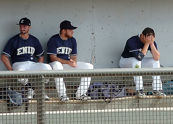 Enid's Elliott Holden (right) sits head in hands after comminting an error against Tulsa Union Saturday at David Allen Memorial Ballpark. (Staff Photo by BILLY HEFTON)