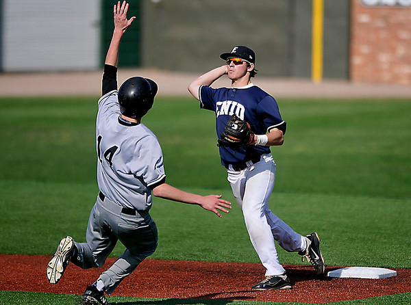 Enid's Braden Rogers throws over Bishop Kelly's Brendan Rodolf to complete a double play Monday at David Allen Memorial Ballpark. (Staff Photo by BILLY HEFTON)