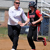 NOC Enid's Kori Barrios is greeted by head coach, Jamie Roberts, as she rounds third after hitting a walk off home run against Carl Albert Wednesday. (Staff Photo by BILLY HEFTON)