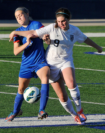 Enid's Sophie Holle competes with Bixby's Torrey Butler for control of the ball Friday at D. Bruce Selby Stadium. (Staff Photo by BILLY HEFTON)