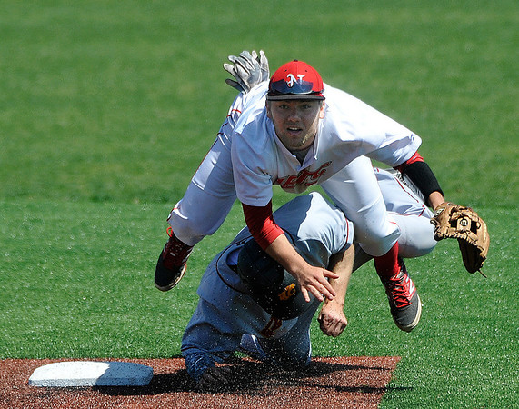 NOC Enid's Dyce Applegate is upended by Redlands Community College's Cole Davis at second base Thursday at David Allen Memorial Ballpark. (Staff Photo by BILLY HEFTON)