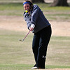 Madison Boler chips on the 9th green Thursday at Meadowlake Golf Course. (Staff Photo by BILLY HEFTON)