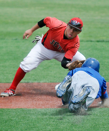 NOC Enid's Dyce Applegate tags out Murray State's Blake Campo trying to steal second Wednesday at David Allen Memorial Ballpark. (Staff Photo by BILLY HEFTON)