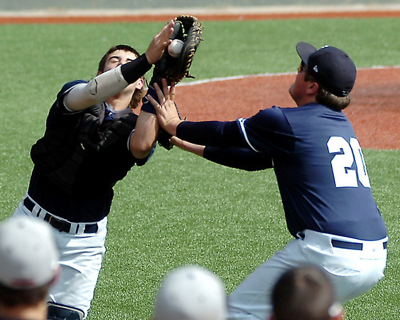 Enid's Kros Bay catches a foul ball in front of Bates Enmeier against Tulsa Union Saturday at David Allen Memorial Ballpark. (Staff Photo by BILLY HEFTON)