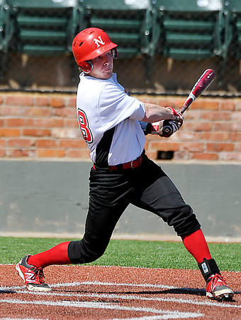 NOC Enid's Haden Johnson gets a bse hit against Dodge City Tuesday at David Allen Memorial Ballpark. (Staff Photo by BILLY HEFTON)