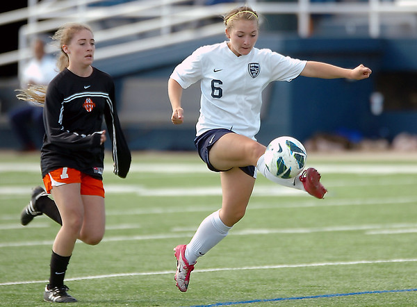 Enid's Brianna Burrow gains control of the ball in front of a Tulsa Washington defender Tuesday at D. Bruce Selby Stadium. (Staff Photo by BILLY HEFTON)