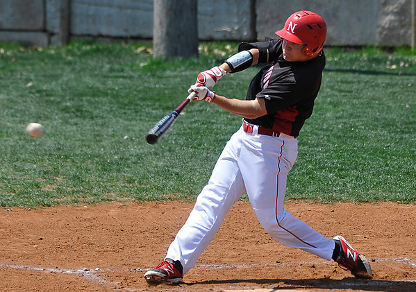 NOC Enid's Russ Colgan connects on a base hit against Carl Albert Friday at Failing Field on the NOC campus. (Staff Photo by BILLY HEFTON)