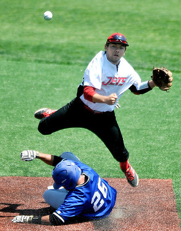 NOC Enid's Dyce Applegate leaps over a sliding Skylar Dean of Pratt College after making a throw to first Tuesday at David Allen Memorial Ballpark. (Staff Photo by BILLY HEFTON)