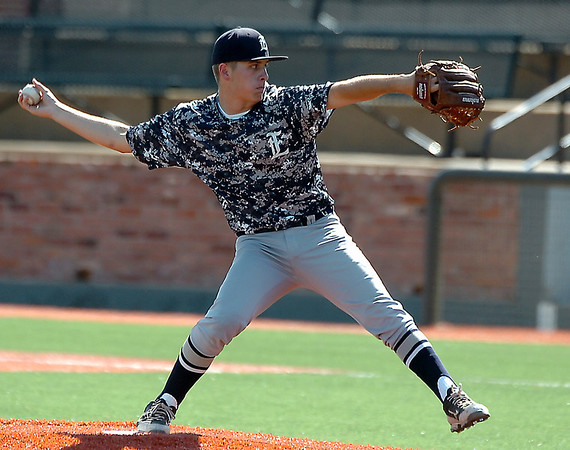 Enid's Jonny Chavez delivers a pitch against Midwest City Friday at David Allen Memorial Ballpark. (Staff Photo by BILLY HEFTON)