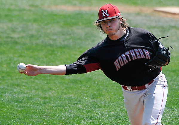 NOC Enid's Scotty Harvill delivers a pitch against Carl Albert Friday at Failing Field on the NOC campus. (Staff Photo by BILLY HEFTON)å