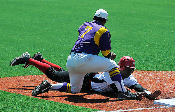 NOC Enid's Nik Gofford dives into third ahead of the tag from Dodge City's Leno Ramirez Tuesday at David Allen Memorial Ballpark. (Staff Photo by BILLY HEFTON)