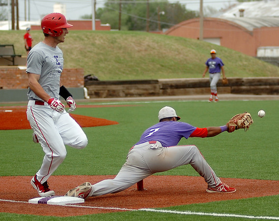 NOC-Enid Jets' Jerame Littell beats the throw to first during the Jets' win over NOC-Tonkawa at David Allen Memorial Ballpark Saturday, April 26, 2014. (Staff Photo by BONNIE VCULEK)