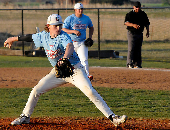 Chisholm's John Voss delivers a pitch against Drummond Friday during the Merrifield Office Plus Invitational. (Staff Photo by BILLY HEFTON)