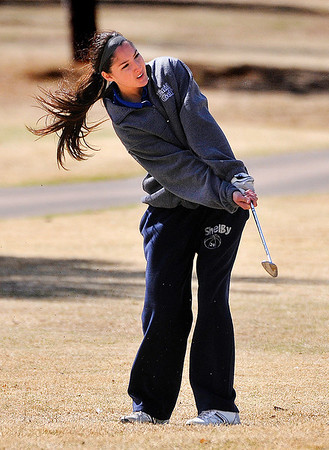 Enid's Sydney Davenport watches her chip on the 9th green Thursday at Meadowlake Golf Course. (Staff Photo by BILLY HEFTON)