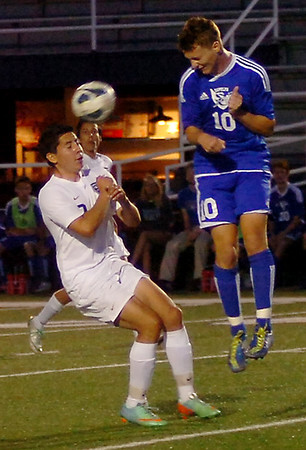 Enid's Armando Gutierrez heads the ball to another Plainsman against Sapulpa at D. Bruce Selby Stadium Friday, April 25, 2014. (Staff Photo by BONNIE VCULEK)