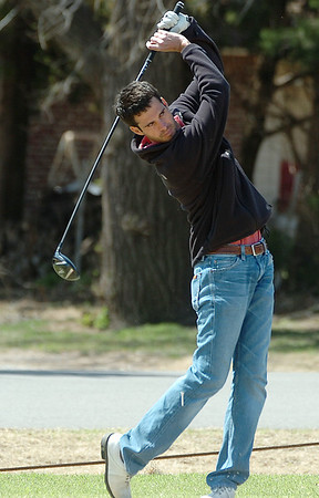 Walker Henson hits his tee shot on the 9th hole Saturday at Meadowlake Golf Course. (Staff Photo by BILLY HEFTON)
